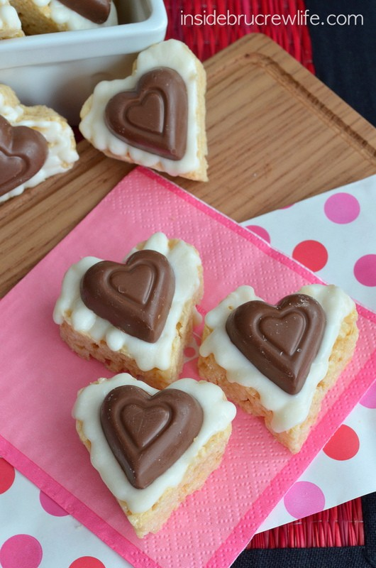 White Chocolate Reese's Krispie Hearts - cute heart shaped ice krispie treats topped with white chocolate and a Reese's peanut butter heart are fun and easy to make.