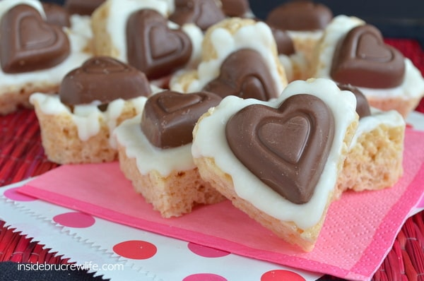 White Chocolate Reese's Krispie Treats - peanut butter cup hearts make these easy no bake treats so fun! Great Valentine's day recipe!