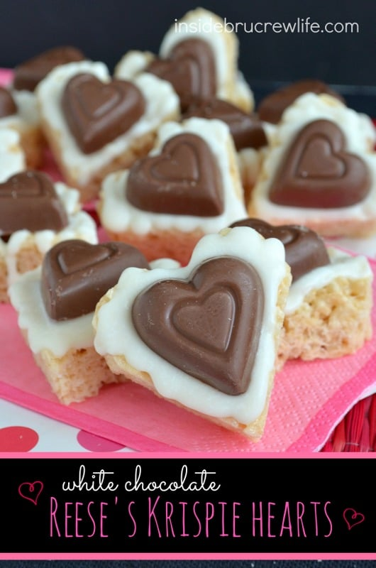 White Chocolate Reese's Krispie Hearts - a fun no bake treat topped with white chocolate and a heart shaped peanut butter cup! Fun Valentine's day treat!