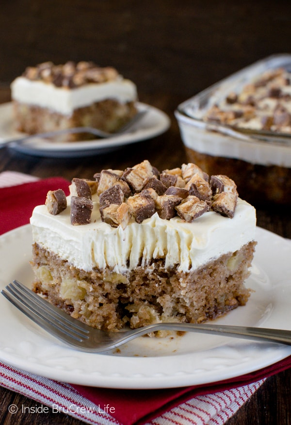 Apple Snickers Cake - delicious cake loaded with lots of fresh apples and candy bars. Perfect dessert for fall parties!