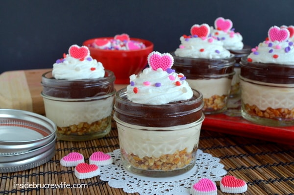 Layers of pretzels, caramel cheesecake, and chocolate pudding makes these easy No Bake Caramel Mud Pie Cups a fun dessert!