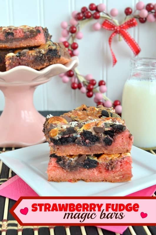 Strawberry Fudge Magic Bars from www.insidebrucrewlife.com - strawberry, fudge, and Oreos in one amazing magic bar