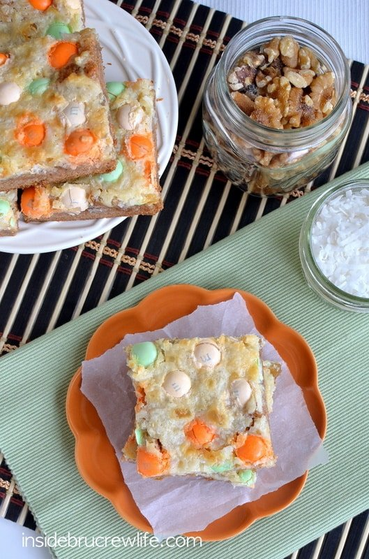 Adding pineapple, nuts, and candies makes these Carrot Cake Magic Bars a fun recipe for the Easter dessert tables.