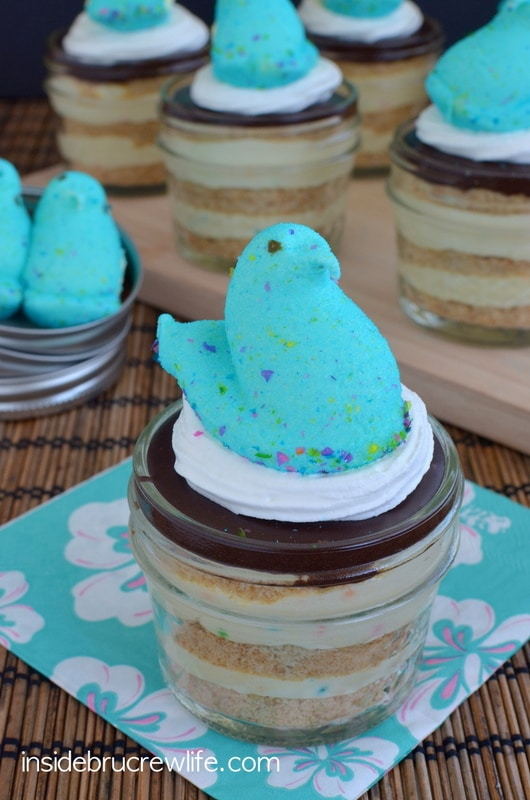Party Peeps Eclair Cake Cups - cake batter pudding layered with graham crackers and chocolate frosting