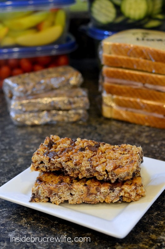 A white plate with two homemade granola bars stacked on it