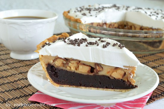 Brownie pie topped with Snickers cheesecake is a fun and delicious way to do dessert!