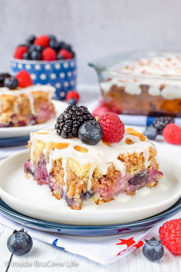 Triple Berry Coffee Cake - fresh fruit and buttery streusel gets baked into this soft coffee cake. Try this easy recipe for breakfast or brunch this summer! #coffeecake #freshfruit #tripleberry #breakfast
