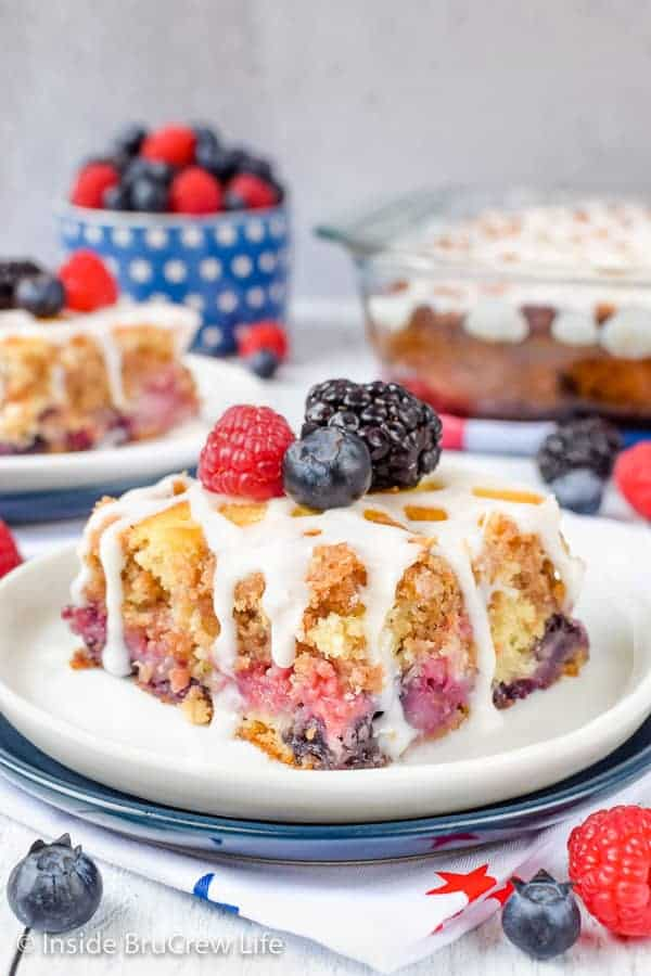 Triple Berry Coffee Cake - this soft buttery cake is loaded with fresh fruit and streusel. Drizzle with glaze and add more berries for a great summer breakfast! #coffeecake #freshfruit #tripleberry #breakfast
