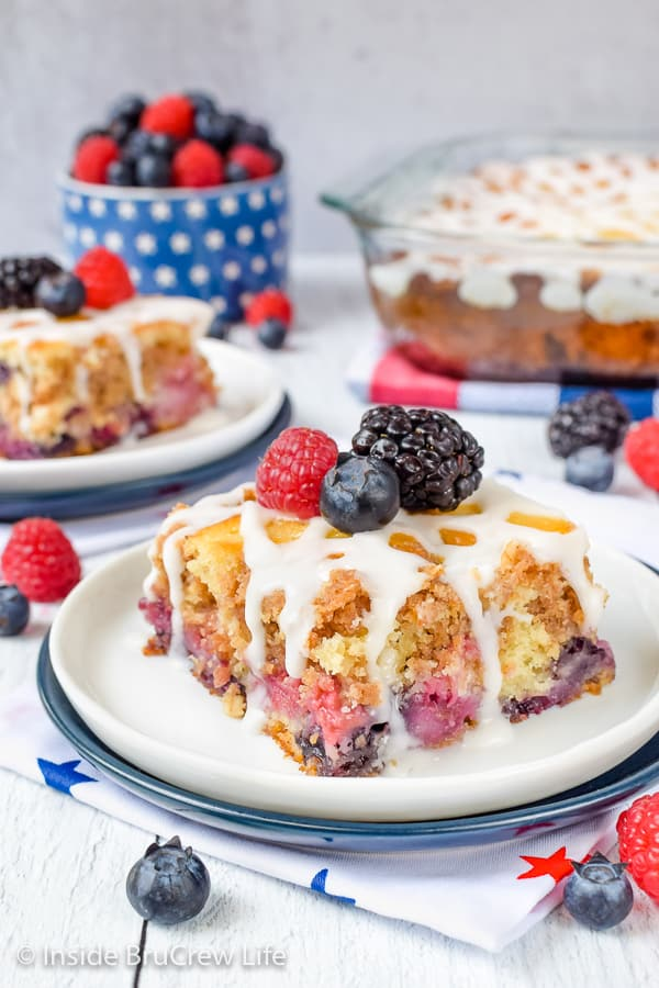 Triple Berry Coffee Cake - a drizzle of sweet glaze adds the perfect finishing touch to this berry coffee cake! Make this easy recipe for breakfast or brunch this summer! #coffeecake #freshfruit #tripleberry #breakfast