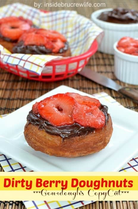 Dirty Berry Doughnuts | Inside BruCrew Life - fried biscuit dough topped with fudge frosting and grilled strawberries #doughnuts #strawberries