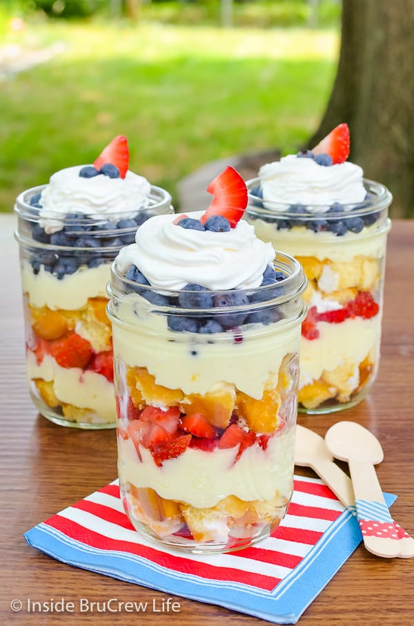 Lemon Mousse Fruit Parfaits - these easy no bake parfaits have layers of snack cakes, lemon cream, and fresh fruit. Make this easy recipe for summer parties and picnics! #nobakedesserts #fruitparfaits #lemoncream #lemonpiefilling #strawberries #blueberries