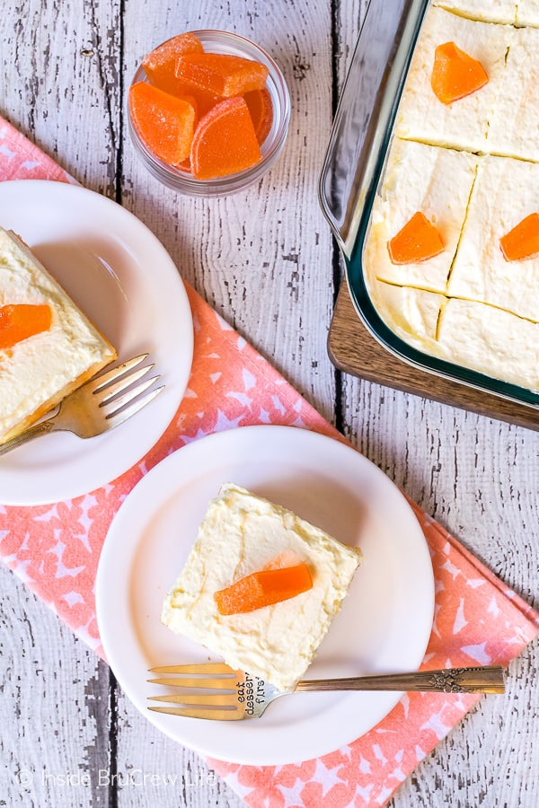 Orange Creamsicle Poke Cake - fluffy vanilla frosting and orange Jello make this the perfect summer dessert. Easy poke cake recipe for picnics and parties! #cake #orange #summerdessert #recipe #Jello #jellocake #puddingfrosting