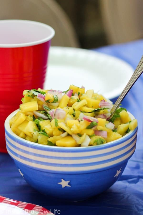 This delicious pineapple mango salsa is great on hot dogs, fish, or chicken, or you can eat it with chips as a side dish.