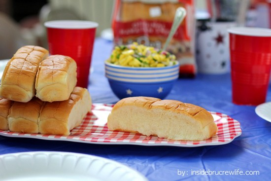 Backyard picnic with King's Hawaiian Rolls, hot dogs, and pineapple mango salsa