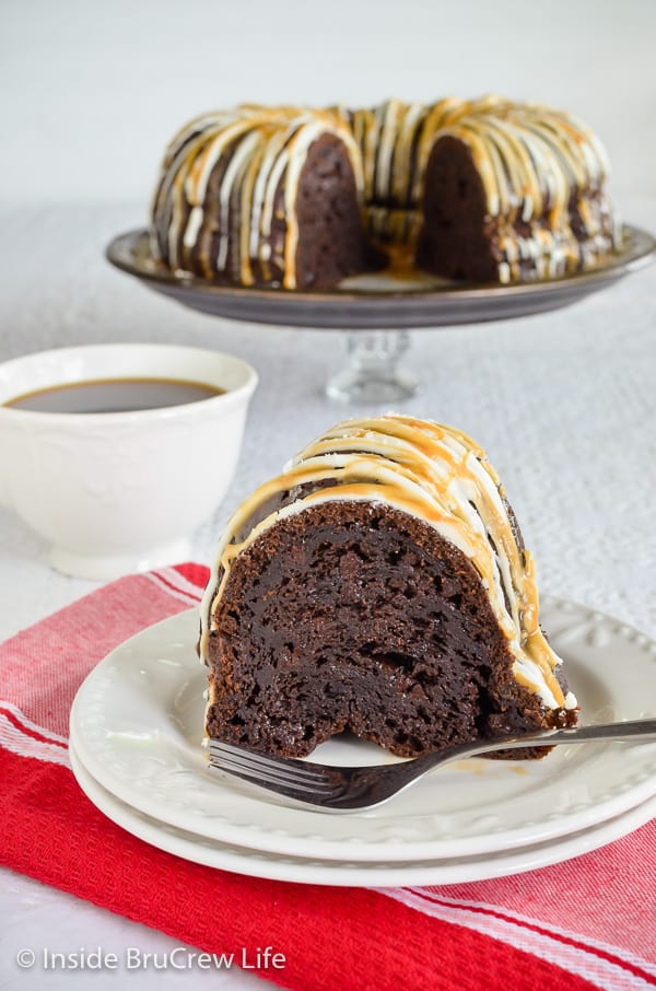 Salted Caramel Mocha Bundt Cake - this easy chocolate Bundt Cake is drizzled with white chocolate and caramel. Easy recipe to make for dessert or parties. #bundtcake #chocolatecake #saltedcaramel #cakemixrecipes