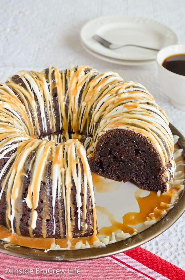 Salted Caramel Mocha Bundt Cake - salted caramel and white chocolate drizzles add so much flavor to this easy chocolate cake. Great recipe to make for dessert. #bundtcake #chocolatecake #saltedcaramel #cakemixrecipes