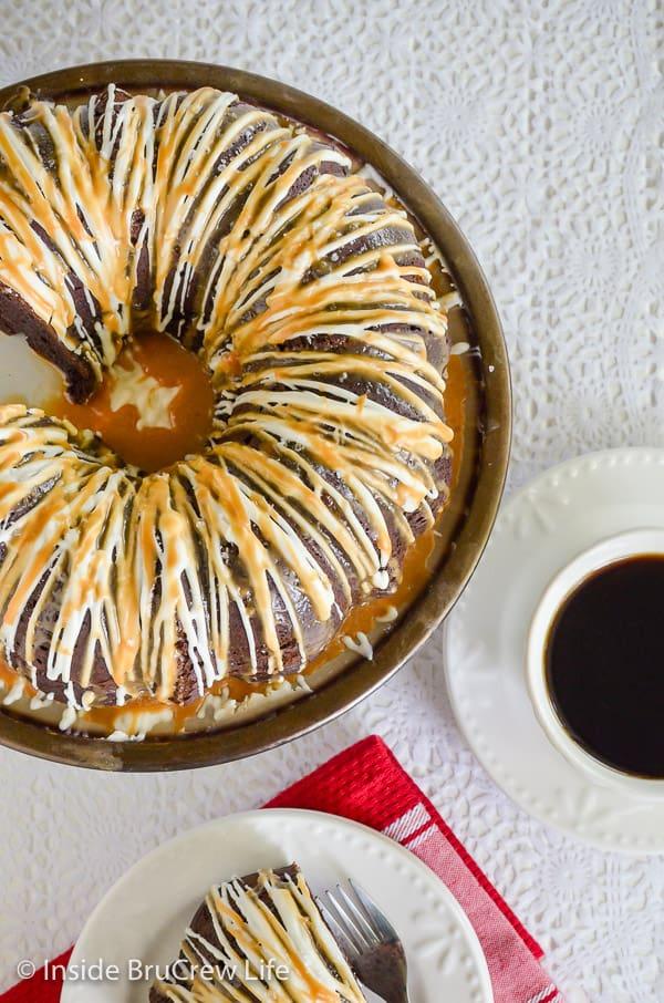 Salted Caramel Mocha Bundt Cake - white chocolate and caramel drizzles make this chocolate Bundt Cake taste amazing. Make this easy recipe for parties or dessert. #bundtcake #chocolatecake #saltedcaramel #cakemixrecipes