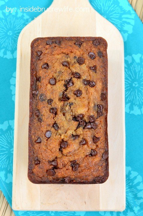 Overhead picture of a loaf of vegan banana bread with chocolate chips on a cutting board