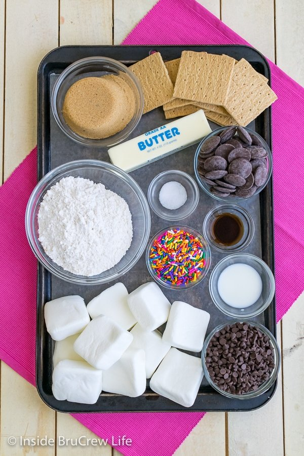 A metal tray with all the ingredients needed to make no bake cookie dough s'mores