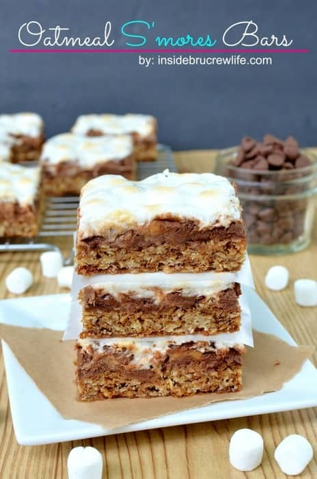 Oatmeal S'mores Bars   Inside BruCrew Life - oatmeal cookie bars topped with chocolate chips, mini marshmallows, and Reese's peanut butter cups #smores #reeses #oatmealcookies