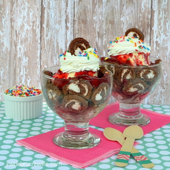 Swiss Cake Roll Ice Cream Sundaes - Swiss Cake Rolls layered with vanilla ice cream and raspberry pie filling for a fun and easy sundae