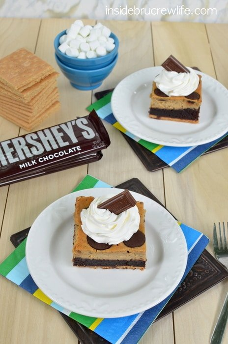 Toasted marshmallow cheesecake, brownies and a graham cracker crust is a fun way to enjoy s'mores for dessert.