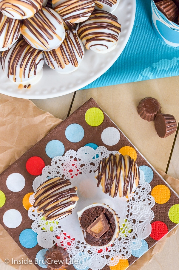 Overhead picture of a plate and napkin with chocolate peanut butter cup cookie dough truffles stacked on them