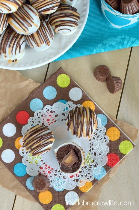 Chocolate Peanut Butter Cup Cookie Dough Truffles - chocolate cookie dough wrapped around a Reese's  peanut butter cup mini and dipped in white chocolate http://www.insidebrucrewlife.com