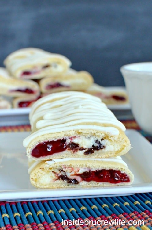 Chocolate chip cheesecake and raspberry pie filling baked inside a crescent roll makes a great breakfast or after school snack