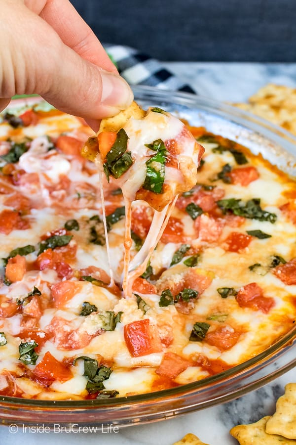 Tomato Basil Pizza Dip - two kinds of melted cheese loaded with tomato and basil makes a delicious appetizer. Easy recipe for game day parties or after school snack. #cheese #dip #hotdip #tomato #gameday #appetizer #afterschoolsnack