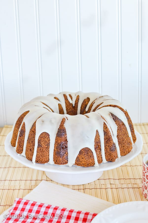 Caramel Apple Bundt Cake - apples, caramel bits, and a sweet glaze make this homemade cake amazing. Great recipe to make for fall parties! #cake #apple #fall #caramelapple #bundtcake #applecider