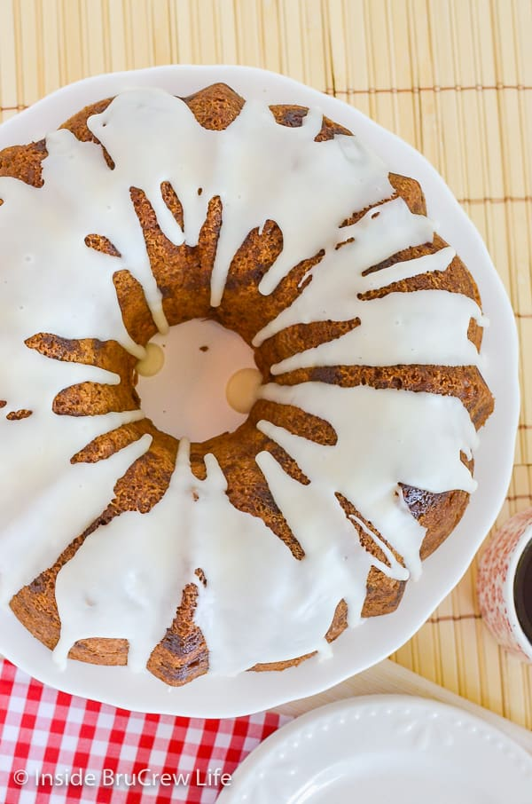 Caramel Apple Bundt Cake - this soft homemade spice cake is loaded with apples and caramel bits. Easy recipe to make for fall parties! #cake #apple #fall #caramelapple #bundtcake #applecider