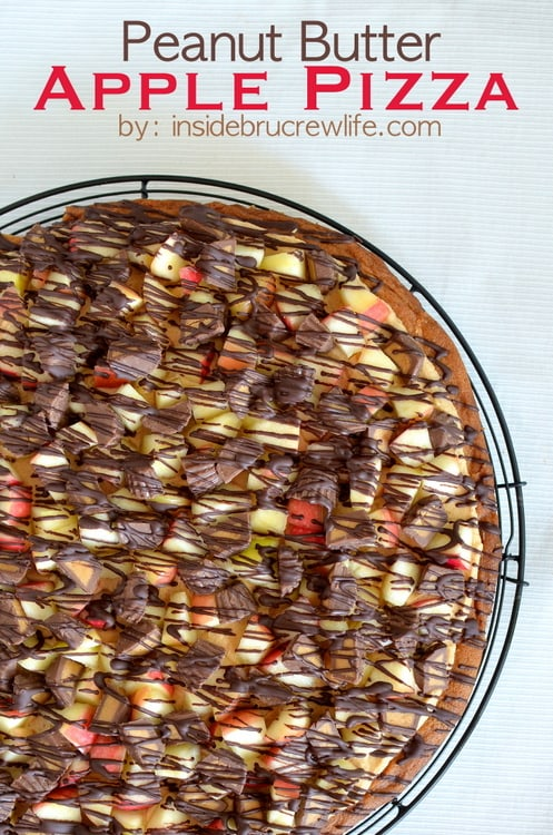 Apples and peanut butter cups on a peanut butter pizza will be your new favorite fall dessert.
