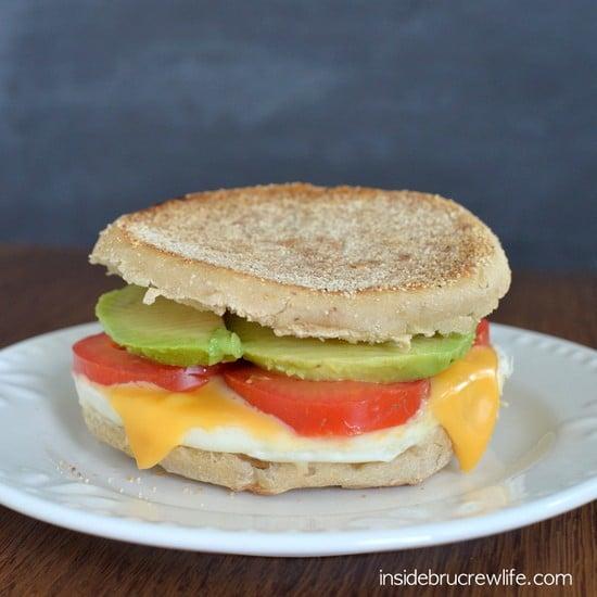 Tomato Avocado Egg Sandwich - the traditional egg sandwich gets a twist from tomato, avocado, and cheese https://www.insidebrucrewlife.com