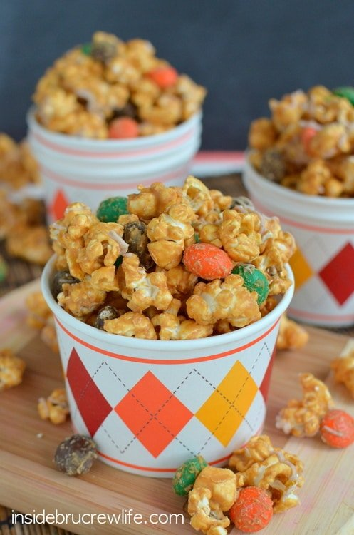 Caramel white chocolate covered popcorn with pumpkin spice M&M candies