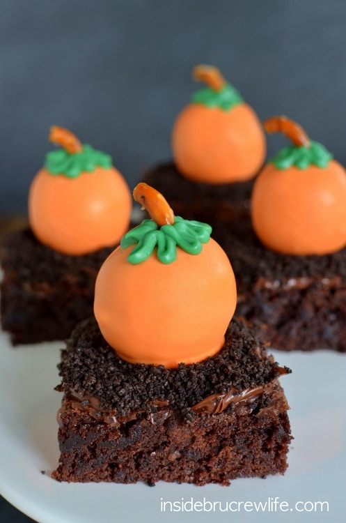 Peanut Butter Pumpkins - peanut butter truffles dipped in orange candy melts to look like pumpkins www.insidebrucrewlife.com