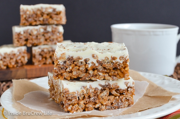 Two pumpkin spice treats made with instant coffee and pumpkin marshmallows stacked on a white plate.