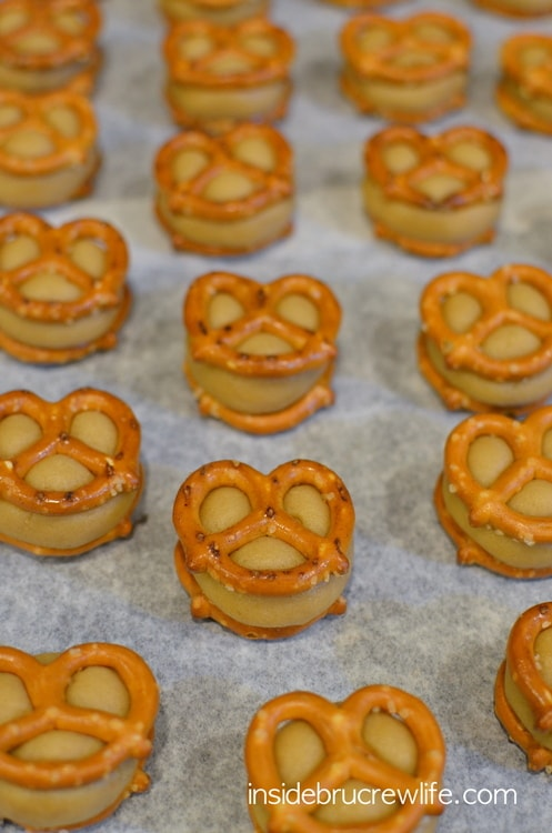 Caramel Pretzel Cookie Dough Bites from www.insidebrucrewlife.com - no bake caramel cookie dough in between pretzels and dipped in chocolate