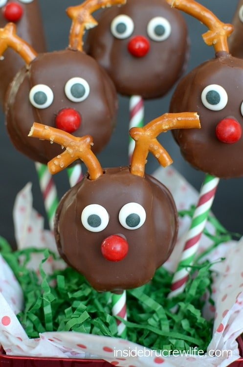 Adding pretzels and candy to store bought cakes makes a cute little reindeer snack cake.
