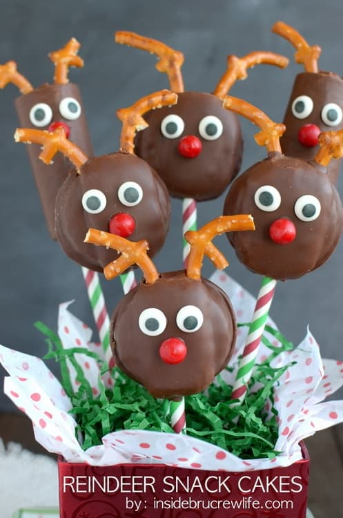 These Reindeer Snack Cakes start with store bought cakes. Add some candy eyes and pretzel antlers to make them into fun little Christmas treats.