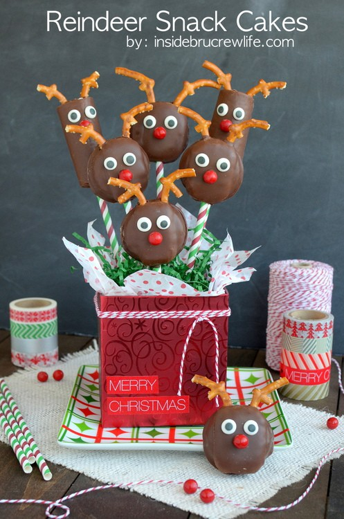 Straws, pretzels, and candy turn store bought cakes into cute little Christmas reindeer snack cakes.