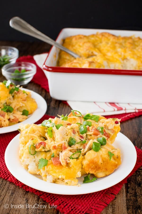 Fiesta Nacho Chicken Bake - cheese, tomatoes, and biscuits make this chicken casserole a hearty comfort food meal. Easy dinner recipe to make on chilly nights!