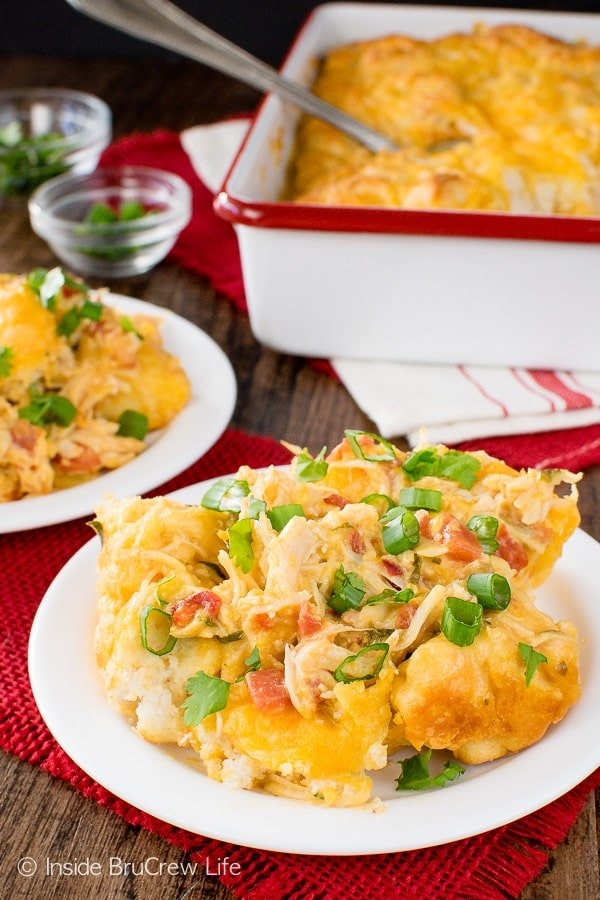 Fiesta Chicken Nacho Bake - adding tomatoes, biscuit, and cheese makes this chicken casserole so easy and delicious. Great dinner recipe for cold nights!
