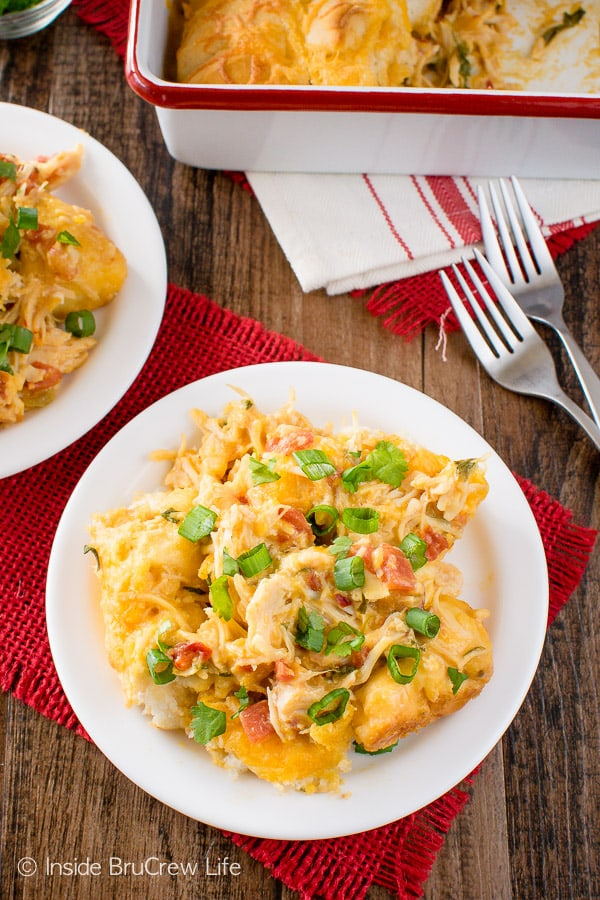 Fiesta Nacho Chicken Bake - this easy chicken casserole is loaded with cheese, biscuits, and tomatoes. Great dinner recipe for those cold winter nights!