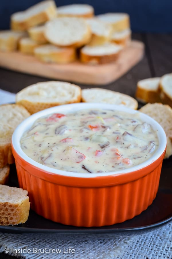 Philly Cheese Steak Queso Dip - beef, peppers, and onions make this white queso dip taste like a Philly cheese steak. Make this easy recipe for game day parties! #dip #queso #cheese #velveeta #phillycheesesteak #gameday #superbowl
