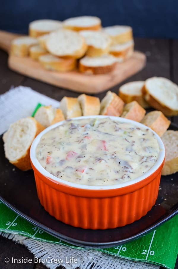 Philly Cheese Steak Queso Dip - enjoy the taste of a Philly Cheese Steak sandwich in a melted queso dip. Peppers, onions, and beef in a melted white queso dip is delicous served with bread or chips. #dip #queso #cheese #velveeta #phillycheesesteak #gameday #superbowl
