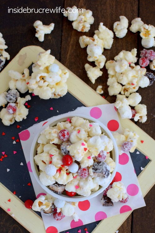 White Chocolate Peppermint Pattie Popcorn - the combo of chocolate covered popcorn and candy will have you devouring the whole bowl. Great snack mix recipe!