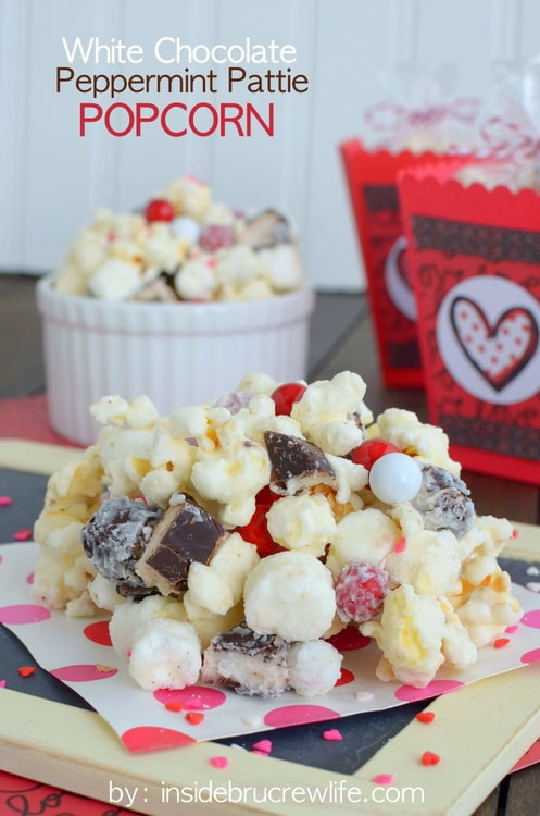 White Chocolate Peppermint Pattie Popcorn - white chocolate covered popcorn loaded with marshmallows, peppermint candies, & sprinkles! Great snack mix recipe!