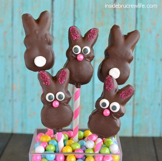 Chocolate Covered Marshmallow Bunnies - candy eyes and sprinkles add a fun flair to these marshmallow bunnies that have been dipped in chocolate.  #bunnies #chocolate #nobake #easter #marshmallowpeeps #eastertreats #easterbasket #dessert