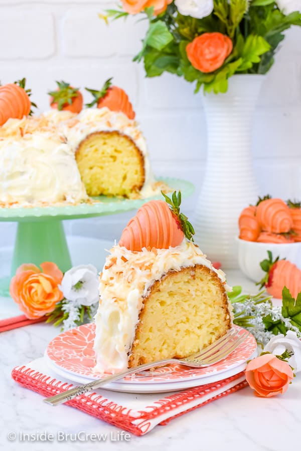 Coconut Cream Bundt Cake - cream cheese frosting and orange chocolate dipped strawberries make this coconut cake a delicious choice for spring parties! #coconut #cake #bundtcake #cakemix #easter